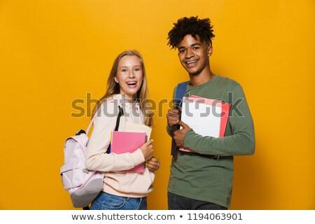 photo of joyful african american man and woman wearing backpacks stock photo © deandrobot