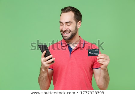 Portrait of a smiling young bearded man Stock photo © deandrobot