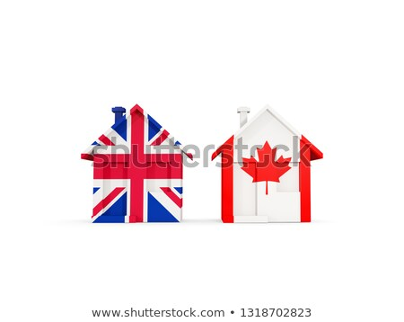 Two houses with flags of United Kingdom and canada Stock photo © MikhailMishchenko