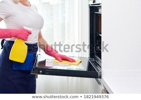 mujer · guante · trapo · limpieza · horno - foto stock © studiolucky