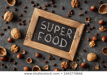 Inscription Super Food, Various nuts on stone table Stock photo © Valeriy