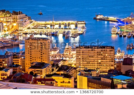 Monte Carlo yachting harbor and colorful waterfront evening view Stock photo © xbrchx