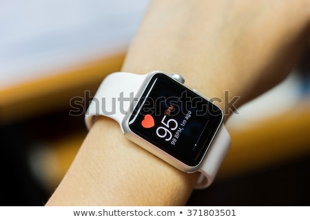 Man's Hand With Mobile And Smartwatch Showing Heartbeat Rate Stock photo © AndreyPopov