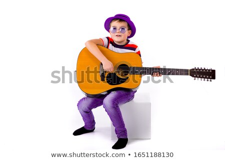 Yellow clothing boy_classic music Stock photo © toyotoyo