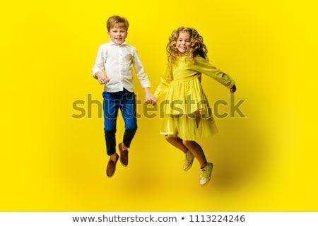 Yellow clothing boy_emotion Stock photo © toyotoyo