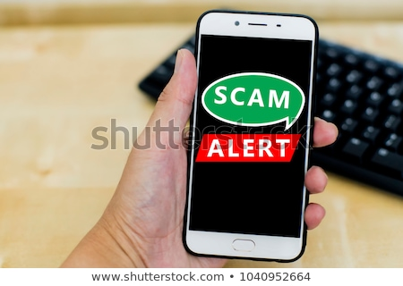 Scam text on red background. Stock photo © szefei