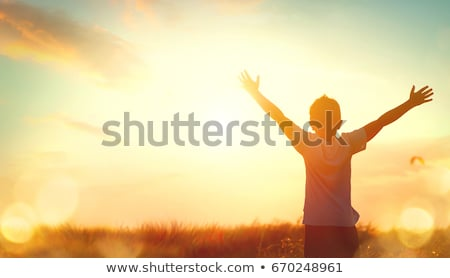 Silhouette of a young child on backlit Stock photo © Lopolo