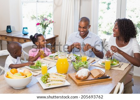 High angle view of African American mother and daughter baking cookies in kitchen at home Stock photo © wavebreak_media
