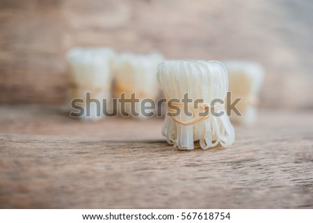 asian uncooked noodles tied with natural rope asian food concept stock photo © galitskaya