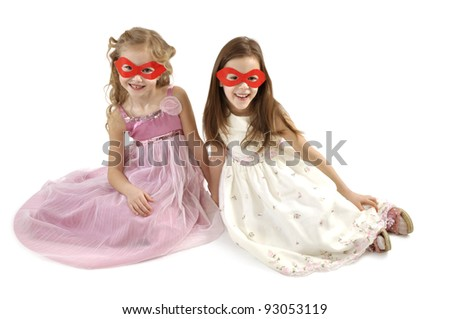 Group of friends in masquerade carnival mask sitting on floor relax after party Stock photo © GVS
