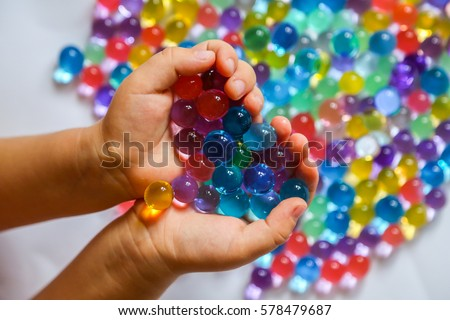 Colored balls of water beads, hydrogel in in hands. Sensory experiences Stock photo © galitskaya