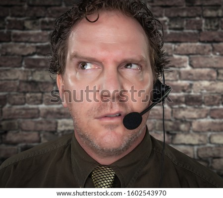 Unfriendly Confused Businessman with Frowning Face Wearing Phone Stock photo © feverpitch