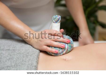 женщину живот массаж ароматический травяной мешки Сток-фото © boggy