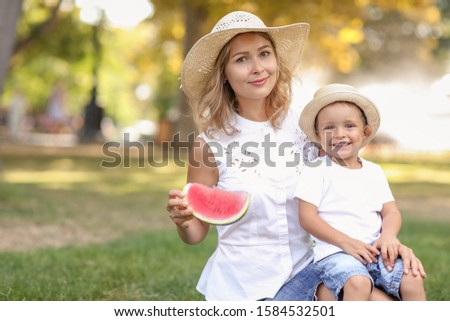 Family of mom and preschooler son on a hot summer day in a public Park for a walk Stock photo © ElenaBatkova