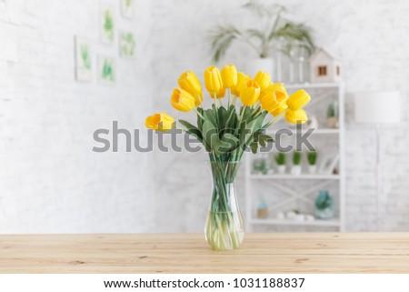 Tulips in a vase on a wooden table. Scandinavian interior. Mockup. Stock photo © ElenaBatkova