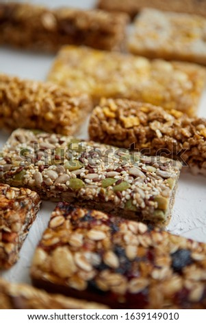 Close up on healthy granola fit bars arragement. Placed on white table Stock photo © dash