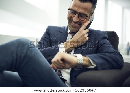 People, work and technology concept. Handsome male economist searches information online on digital  Stock photo © vkstudio