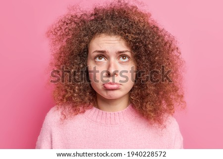 Stock fotó: Photo Of Displeased Unhappy Young Woman With Curly Bushy Blonde Hair Frowns Face In Bewilderment W
