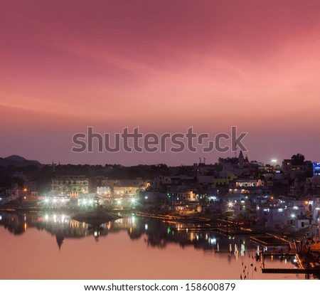 Sacred Puskhar lake (Sagar) and ghats of town Pushkar in twilig Stock photo © dmitry_rukhlenko