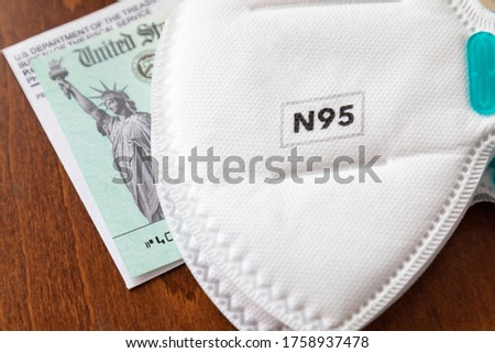 N95 Medical Face Mask Resting On IRS Covid-19 Economic Relief Ch Stock photo © feverpitch