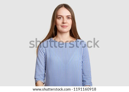 Feminity, beauty, wellness concept. Satisfied brunette lady touches jawline gently, has applied make Stock photo © vkstudio