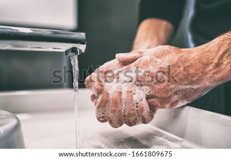 Coronavirus pandemic prevention wash hands with soap warm water and , rubbing nails and fingers wash Stock photo © Maridav