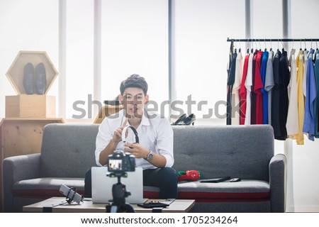 Asian man technology blogger or Social media influencer presenti Stock photo © snowing