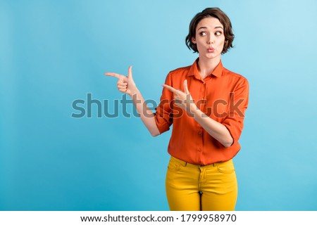 Photo of excited beautiful woman expressing surprise and screaming Stock photo © deandrobot