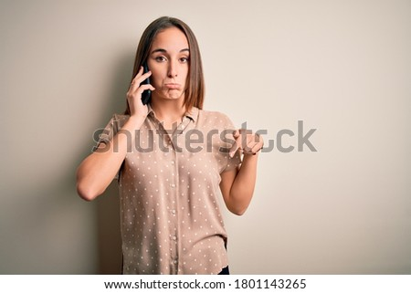 Displeased Caucasian Woman Holding Sign and Pointing White Backg Stock photo © Qingwa