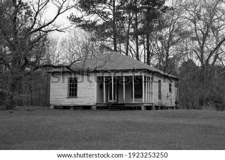 abandoned shack cabin house home wood structure grunge weathered Stock photo © jeremywhat