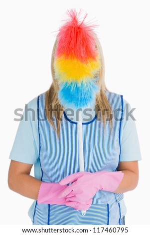 Cleaner holding a feather duster in front her face in the white background Stock photo © wavebreak_media