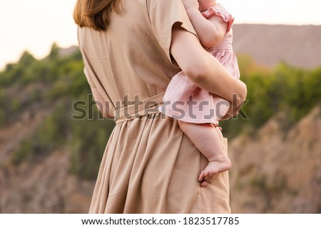 rear view of a young asian woman standing with her arms akimbo in prisoners uniform stock photo © bmonteny