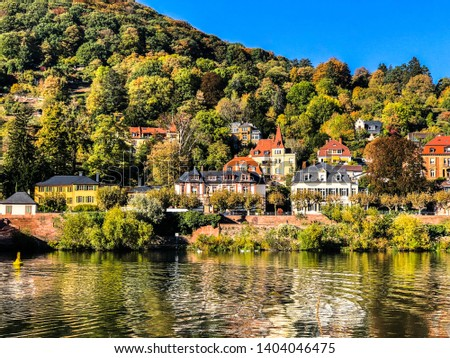 Neckar valley with reflection of Heidelberg houses at the river  Stock photo © meinzahn