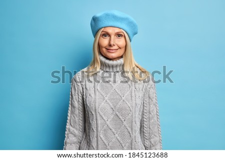 blond women wearing casual grey knitted sweater and blue jeans stock photo © zastavkin