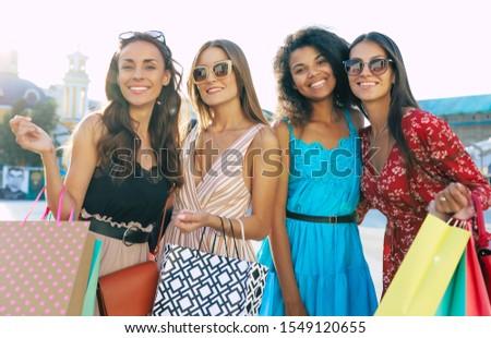 Four girlfriends with a lot of shoppings Stock photo © konradbak