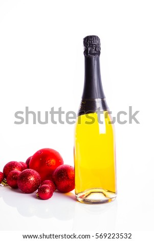 closeup of a red dull christmas ball with champagne glass bottom in front of a champagne bottle Stock photo © Rob_Stark