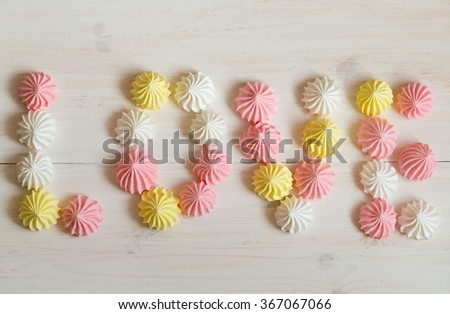 Inscription love meringue made of pastel colors on a white woode Stock photo © vlad_star