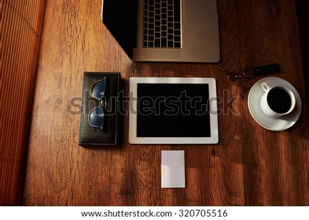 Tablet touch computer gadget on wooden table Stock photo © michaklootwijk