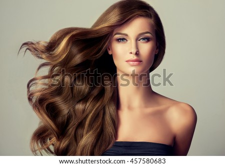 Makeup. Wavy hair. Beautiful brunette girl with long shiny healt Stock photo © Victoria_Andreas