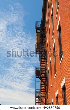The typical american fire escape ladder zigzagging across the fa Stock photo © CaptureLight
