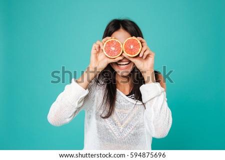 美 · 小さな · ブルネット · 女性 · グレープフルーツ · 孤立した - ストックフォト © iordani