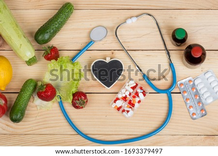 Stethoscope and pharmaceuticals on a blackboard with copy space Stock photo © Zerbor