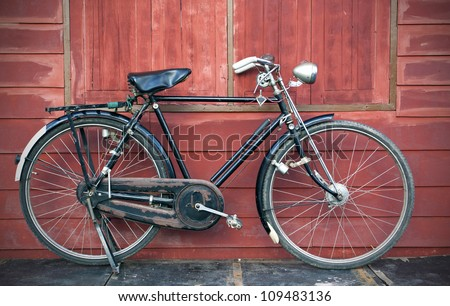 Man on vintage retro old bicycle on old city background. Vector  Stock photo © NikoDzhi