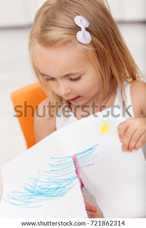 Little girl involved in a hand crafting project - using safety s Stock photo © ilona75