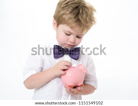 close up of businessman putting coin into small piggy bank the stock photo © snowing
