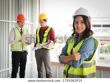 Two professional male and female engineers working and discuss w Stock photo © FrameAngel