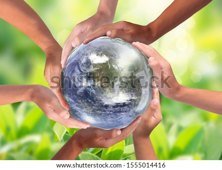 conceptual symbol of a green earth globe with multiracial human stock photo © rufous