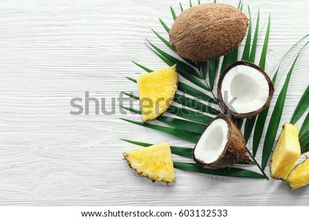 Composition from a palm leaf, halves of pineapple and carambola  Stock photo © artjazz
