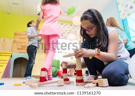 cute girl building a structure from toy blocks during playtime stock photo © kzenon