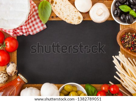 charcoal wooden menu board with homemade spaghetti pasta with quail eggs and cheese on wooden backgr stock photo © denismart